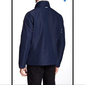 Marc New York by Andrew Marc Mens Kips Bay City Rain Jacket with Faux Fur Trim Collar